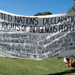 United Nations Declaration Banner drawing attention to indigenous rights.  Many aboriginals were denied the right to vote and those that did, were told get something or nothing because we will compulsorily acquire your land anyway.